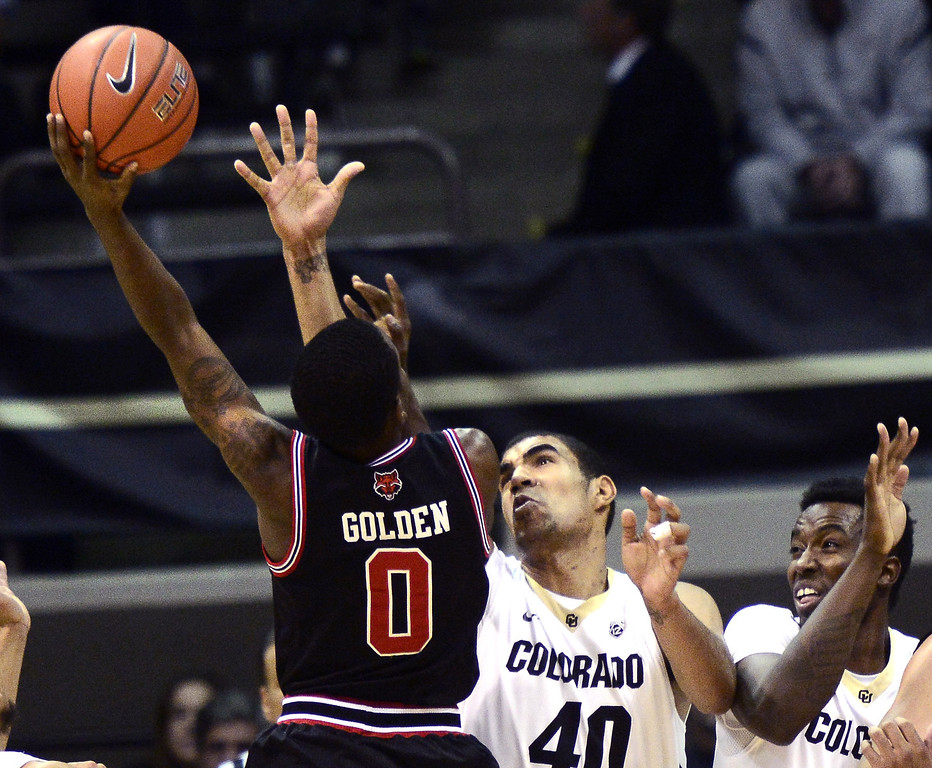 . Colorado\'s Josh Scott (40) defends against Arkansas State\'s Cameron Golden (0) during an NCAA college basketball game at the Coors Events Center on the  in Boulder, Colo. Monday, Nov. 18, 2013.  Photo by Paul Aiken / The Boulder Daily Camera.