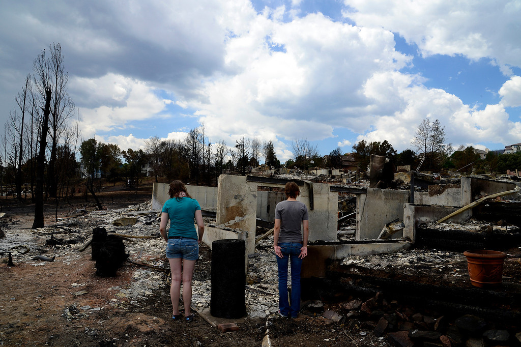 . Sisters, Nina Foster, 17, left, and Eliza Foster, 19, return to the remains of their family\'s home for the first time since they were evacuated, Sunday, July 1, 2012. Their home, on Courtney Drive in the Mountain Shadows subdivision in Colorado Springs, was one of over 350 homes burned in the Waldo Canyon Fire. Mahala Gaylord, The Denver Post
