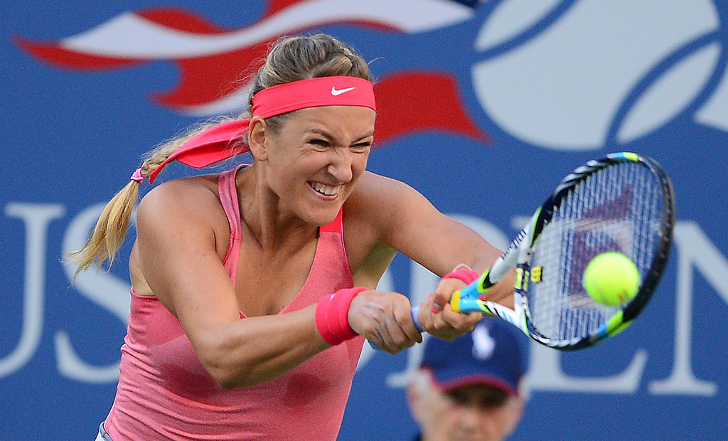. Belarus tennis player Victoria Azarenka plays a shot against Serena Williams of the US during the 2013 US Open women\'s final at the USTA Billie Jean King National Tennis Center in New York on September 8, 2013.    EMMANUEL DUNAND/AFP/Getty Images
