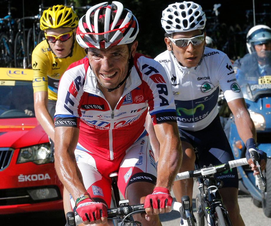 . Christopher Froome of Britain, wearing the overall leader\'s yellow jersey, Joaquim Rodriguez of Spain, and stage winner Nairo Alexander Quintana of Colombia, wearing the best young rider\'s white jersey, climb during the 20th stage of the Tour de France cycling race over 125 kilometers (78.1 miles) with start in in Annecy and finish in Annecy-Semnoz, France, Saturday July 20 2013. (AP Photo/Christophe Ena)