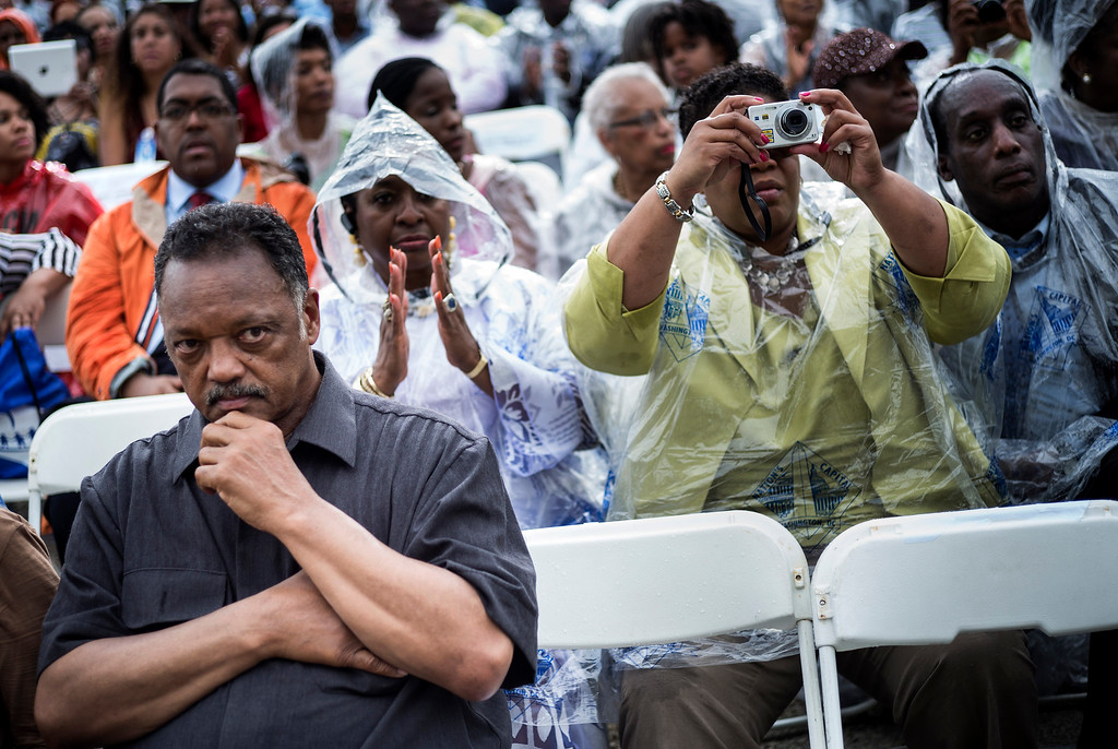 ". The Reverend Jesse Jackson and other wait to listen to US President Barack Obama speak at the Lincoln Memorial on the National Mall August 28, 2013 in Washington, DC. Obama and others spoke to commemorate the 50th anniversary of the US civil rights era March on Washington where Martin Luther King Jr. delivered his ""I Have a Dream Speech\"". AFP PHOTO/Brendan SMIALOWSKI/AFP/Getty Images"