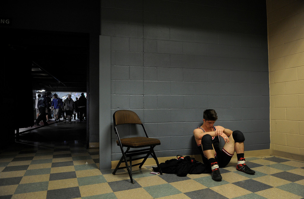 . DENVER, CO. - FEBRUARY 21: Elizabeth High School junior John Leonard sat alone with his thoughts after losing a consolation match Friday afternoon. The CHSAA State Wrestling Tournament continued Friday, February 22, 2013 with quarterfinal and semifinal matches at the Pepsi Center in Denver. (Photo By Karl Gehring/The Denver Post)