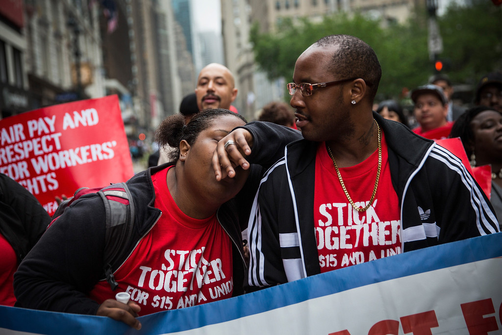 . A protester demanding higher wages for fast food workers takes a brief moment of rest during a massive rally on May 15, 2014 in New York City.   (Photo by Andrew Burton/Getty Images)