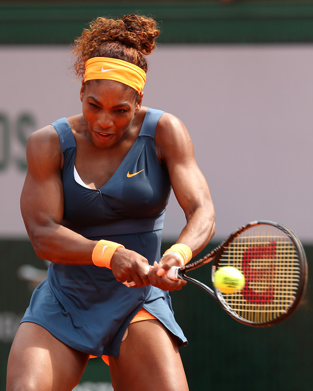 . Serena Williams of United States of America plays a backhand in her Women\'s Singles Final match against Maria Sharapova of Russia  during day fourteen of French Open at Roland Garros on June 8, 2013 in Paris, France.  (Photo by Julian Finney/Getty Images)