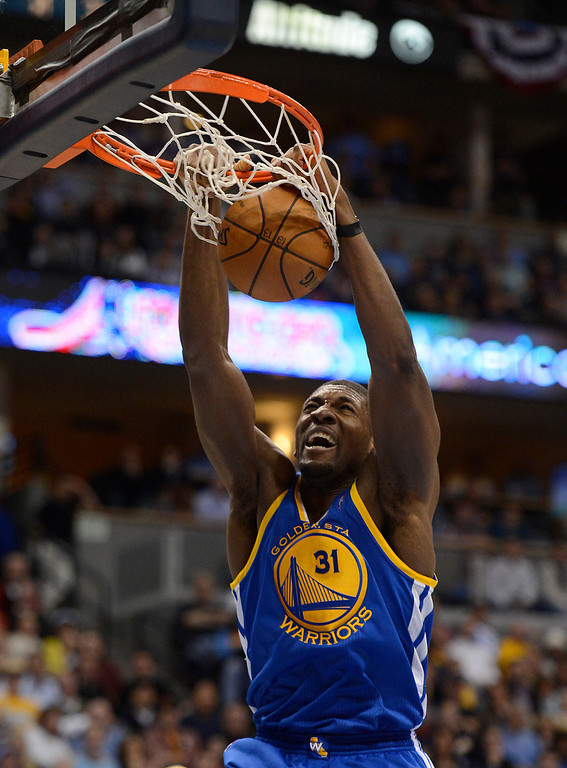 . DENVER, CO. - APRIL 23: Golden State Warriors center Festus Ezeli (31) dunks the ball in the fourth quarter. The Denver Nuggets took on the Golden State Warriors in Game 2 of the Western Conference First Round Series at the Pepsi Center in Denver, Colo. on April 23, 2013. (Photo by John Leyba/The Denver Post)