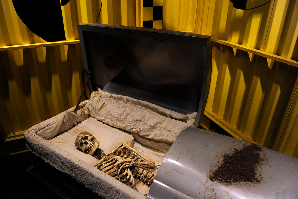 . As visitors enter the exhibit, they are greeted by the Buried Alive Coffin. The Denver Museum of Nature and Science hosts MythBusters: The Explosive Exhibition which opens to the public Oct. 11 and  runs through Jan. 5, 2014. The exhibit uses interactive technology that allows visitors to spend the day as a MythBuster using the same methods as the hosts of Discovery Channel�s series MythBusters. Guest can experiment with Running in the Rain, Blind Driving, and Killer Card Toss. (Photo By Kathryn Scott Osler/The Denver Post)