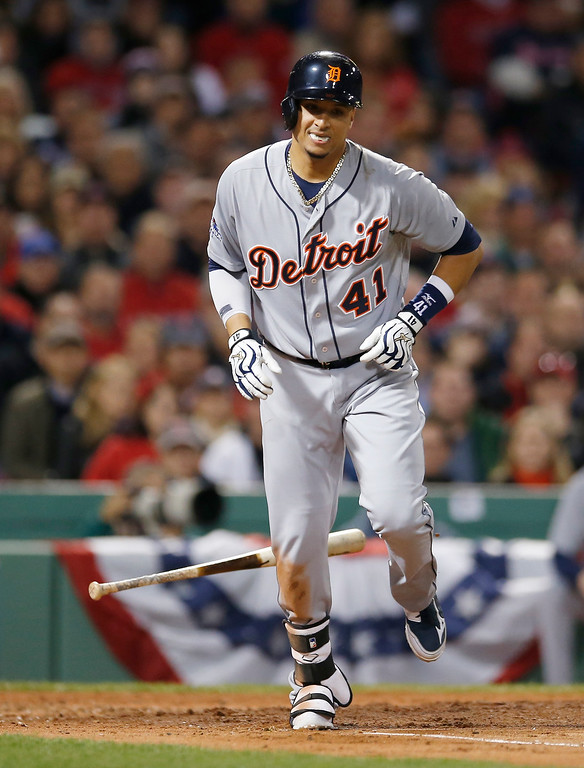 . Detroit Tigers\' Victor Martinez runs to first base after getting hit by a pitch by Boston Red Sox\'s Clay Buchholz in the fourth inning during Game 2 of the American League baseball championship series Sunday, Oct. 13, 2013, in Boston. (AP Photo/Elise Amendola)