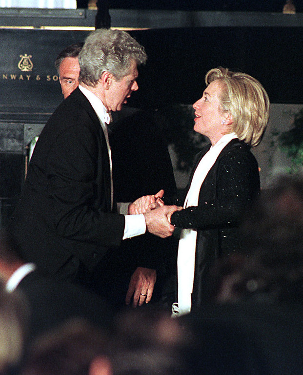 . Van Cliburn and U.S. First Lady Hillary Rodham Clinton hold hands after his performance at the state dinner for Prime Minister Obuchi of Japan on May 3, 1999.  (Photo By Pool/Getty Images)