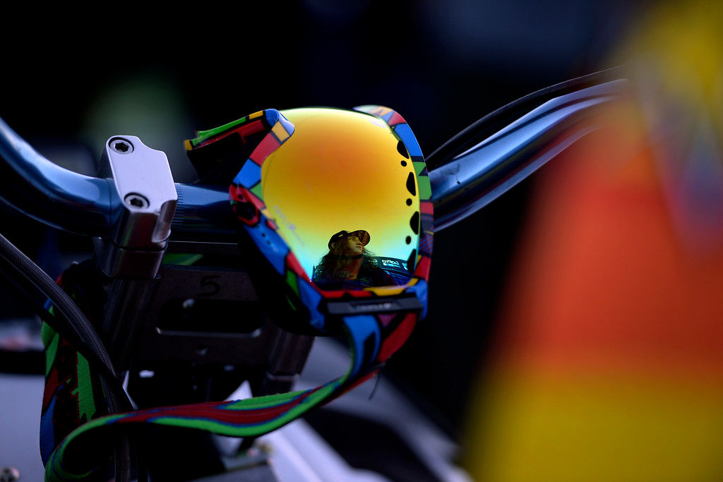 . Colten Moore is reflected in his goggles as they hang on his sled in the longest jump competition before a celebration of his late brother, Caleb, who was killed in the snowmobile freestyle event at the 2013 X Games Aspen. X Games Aspen at Buttermilk on Friday, January 25, 2014. (Photo by AAron Ontiveroz/The Denver Post)