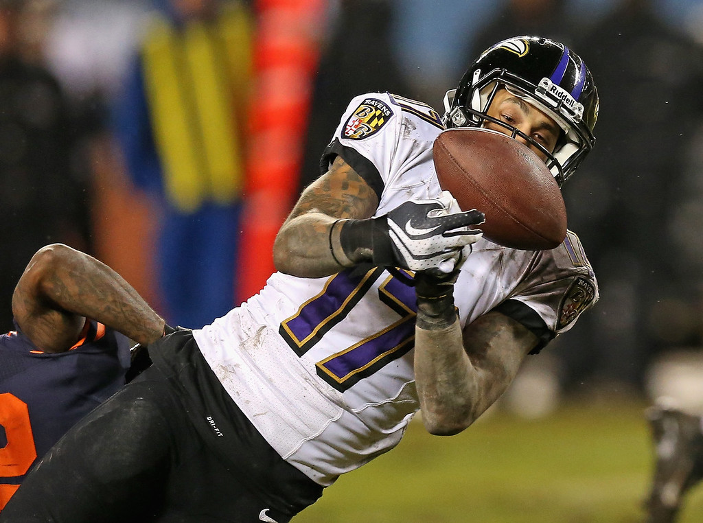 . Tandon Doss #17 of the Baltimore Ravens drops a potential first down pass in overtime against the Chicago Bears at Soldier Field on November 17, 2013 in Chicago, Illinois. The Bears defeated the Ravens 23-20 in overtime. (Photo by Jonathan Daniel/Getty Images)