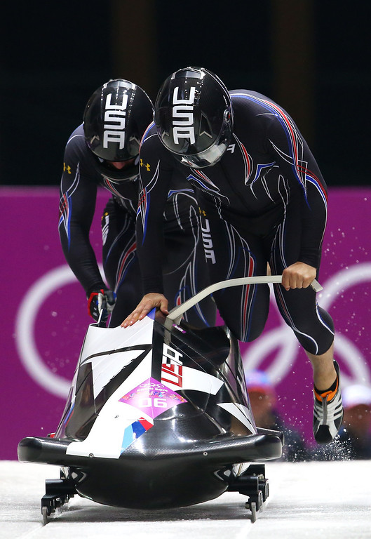. Pilot Nick Cunningham and Dallas Robinson of the United States team 3 make a run during the Men\'s Two-Man Bobsleigh heats on Day 9 of the Sochi 2014 Winter Olympics at Sliding Center Sanki on February 16, 2014 in Sochi, Russia.  (Photo by Alex Livesey/Getty Images)