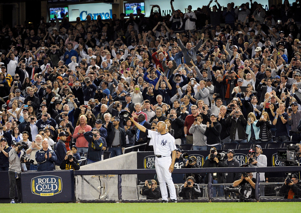 . New York Yankees relief pitcher Mariano Rivera tips his cap to the fans during the ninth inning of the Yankees\' baseball game against the Tampa Bay Rays on Thursday, Sept. 26, 2013, at Yankee Stadium in New York. The Rays won 4-0 in Rivera\'s final home game. (AP Photo/Bill Kostroun)