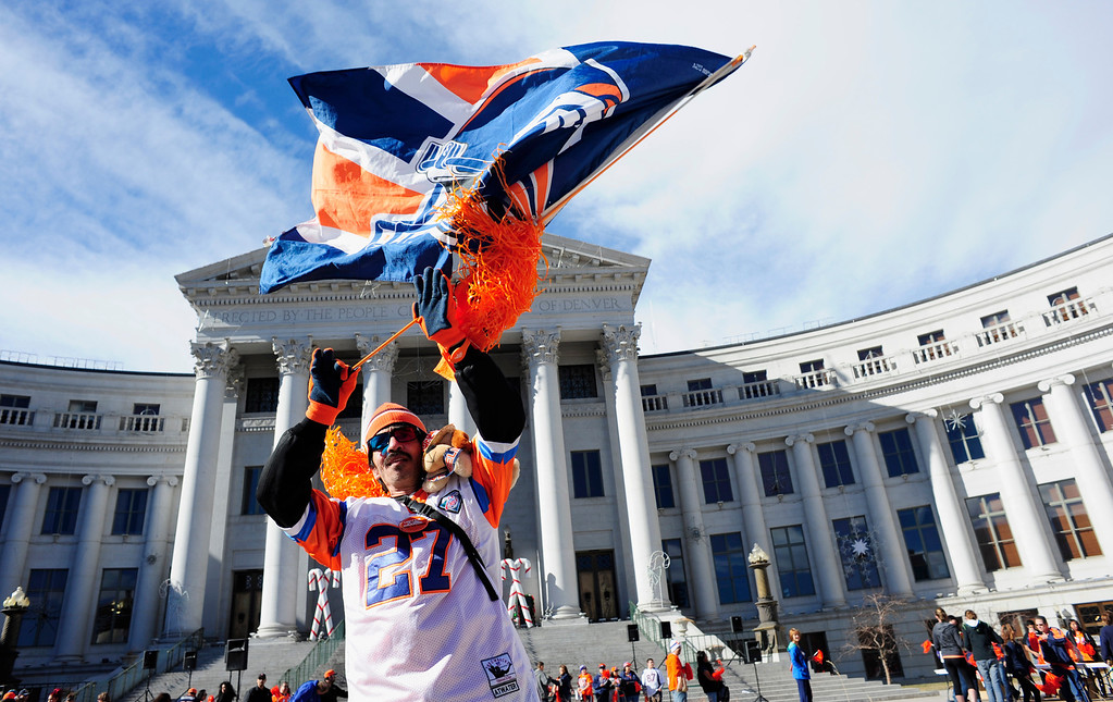 . Donald Rodriguez, 54, of Lakewood, waves a Broncos flag during a rally to send off the team, at the City and County Building in Denver, Colorado, Sunday, January 26, 2014. The noon rally brought out scores of supporters and included an appearance by Governor John Hickenlooper and Denver Mayor Michael Hancock.  (Photo By Brenden Neville / Special to The Denver Post)
