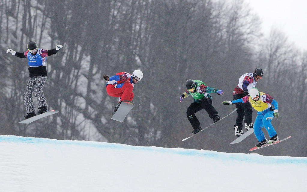 . (L-R) Jussi Taka of Finland (blue bib), Pierre Vaultier of France (red bib), Jarryd Hughes of Australia (green bib), Emil Novak of the Czech Republic (white bib) and Hanno Douschan of Austria (yellow bib) compete in the Men\'s Snowboard Cross 1/8 Finals on day eleven of the 2014 Winter Olympics at Rosa Khutor Extreme Park on February 18, 2014 in Sochi, Russia.  (Photo by Adam Pretty/Getty Images)