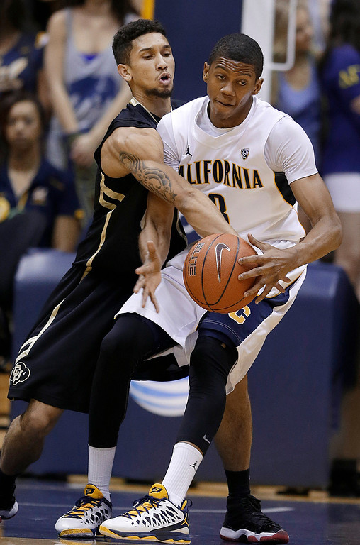 . Colorado guard Askia Booker (0) reaches for the ball as he defends California guard Tyrone Wallace during the first half of an NCAA college basketball game in Berkeley, Calif., Saturday, March 2, 2013. (AP Photo/Jeff Chiu)