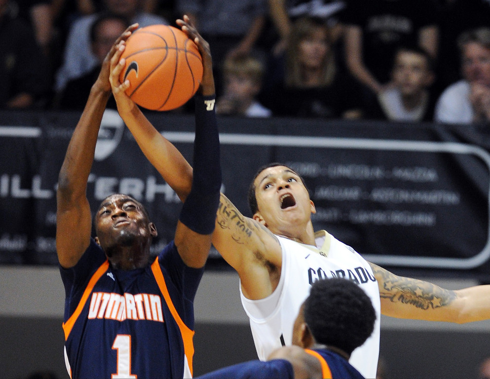. Dee Oldham, left, of Tenn-Martin, tries to keep the ball from Dustin Thomas of Colorado, during the first half of the   game in Boulder, Colo., Sunday, Nov. 10, 2013. (The Daily Camera/Cliff Grassmick)