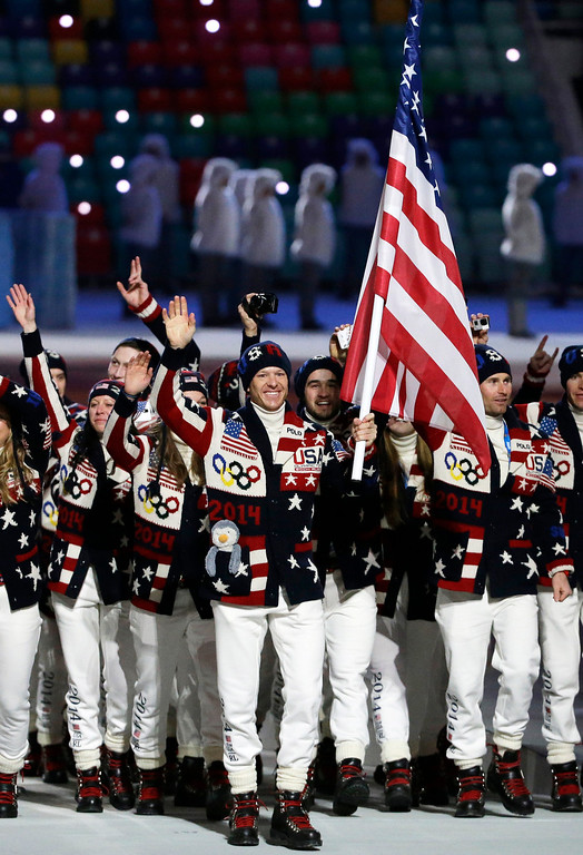 . Todd Lodwick of the United States carries the national flag as he leads the team during the opening ceremony of the 2014 Winter Olympics in Sochi, Russia, Friday, Feb. 7, 2014. (AP Photo/Mark Humphrey)