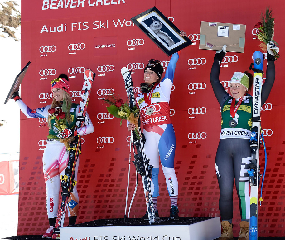 . First placed Lara Gut of Switzerland (C),  with second placed Tina Weirather of Liechtenstein (L), and Elena Fanchini of Italy (R) on the winners podium after the women\'s downhill race at the FIS World Cup Alpine Skiing in Beaver Creek, Colorado, USA, 29 November 2013.  EPA/JOHN G. MABANGLO