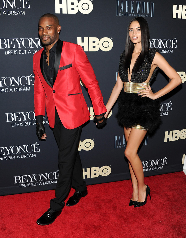 """. Models Tyson Beckford and Shanina Shaik attend the premiere of \""""Beyonce: Life Is But A Dream\"""" at the Ziegfeld Theatre on Tuesday, Feb. 12, 2013 in New York. (Photo by Evan Agostini/Invision/AP)"""
