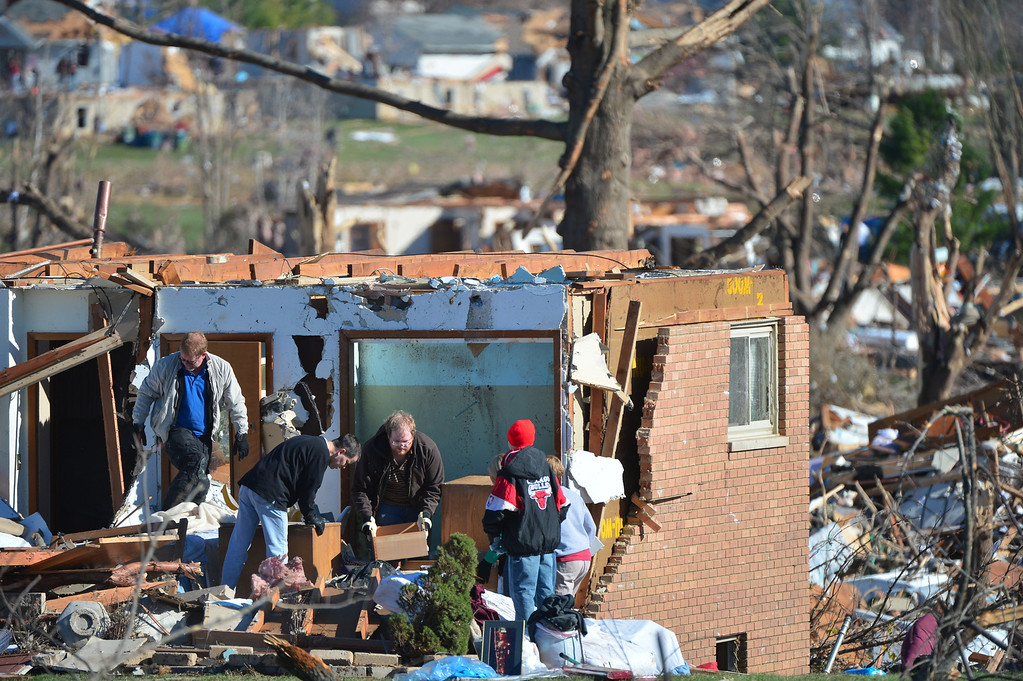 . Homeowners dig out what they can Tuesday, Nov. 19, 2013 after more than 1,000 homes were devastated by a F4 tornado that passed through Sunday, in Washington, Ill. The twister was the most powerful to hit Illinois since 1885 with wind speeds greater than 200 mph. (AP Photo/Journal Star, Fred Zwicky)