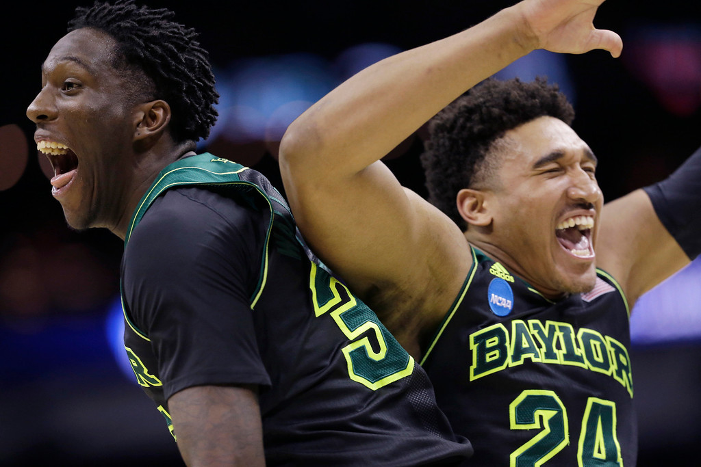 . Baylor\'s Taurean Prince, left, and Ish Wainright, right, celebrate their win over Creighton in a third-round game in the NCAA college basketball tournament Sunday, March 23, 2014, in San Antonio. Baylor won 85-55. (AP Photo/David J. Phillip)