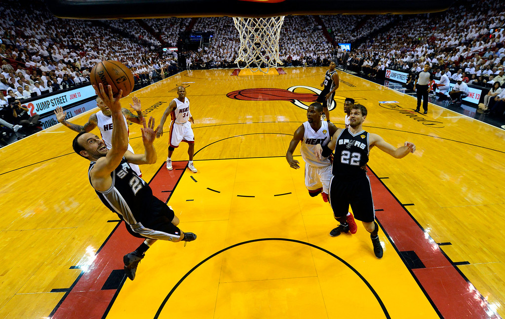 . San Antonio Spurs guard Manu Ginobili (20) goes to the basket against the Miami Heat in the first half in Game 3 of the NBA basketball finals in Miami, Tuesday, June 10, 2014. (AP Photo/Steve Mitchell, Pool)