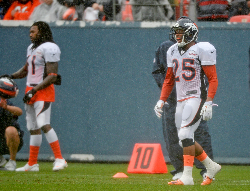 . Denver Broncos cornerback Chris Harris (25) was back on the field during a rain day on day six of the Denver Broncos 2014 training camp July 30, 2014 at Sports Authority Field at Mile High Stadium.  (Photo by John Leyba/The Denver Post)