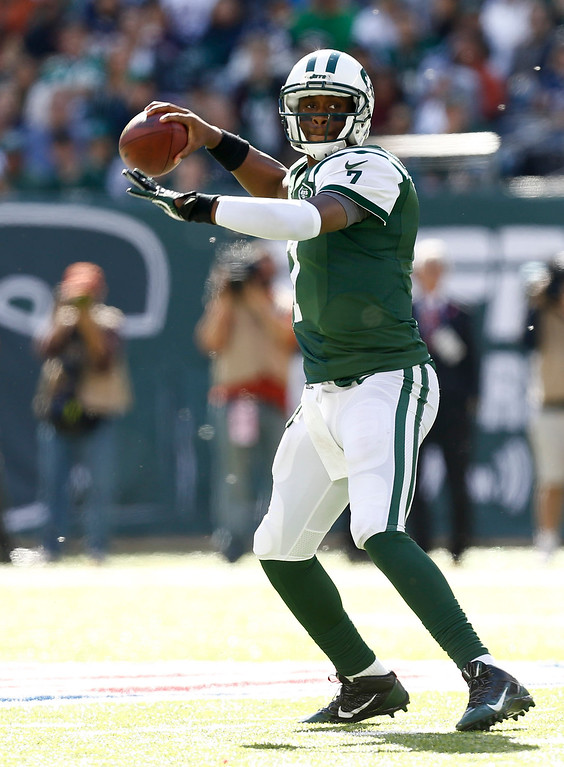 . Geno Smith #7 of the New York Jets passes against the New England Patriots during their game at MetLife Stadium on October 20, 2013 in East Rutherford, New Jersey.  (Photo by Jeff Zelevansky/Getty Images)