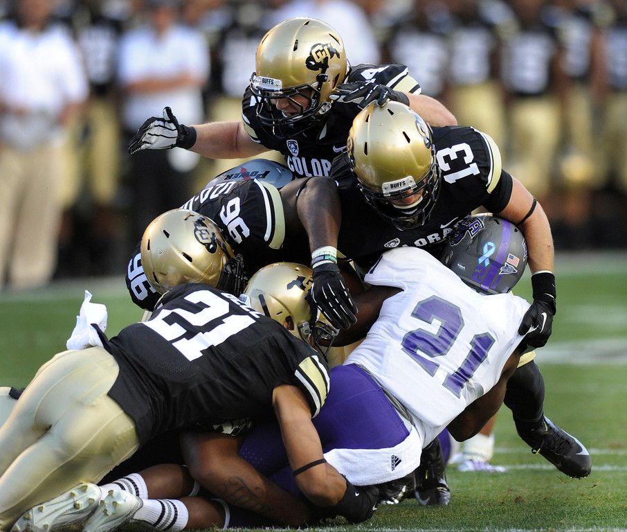 . BOULDER, CO. - SEPTEMBER 76: Buffs defenders swarmed to Bears\' running back Willie Mathews (21) in the first quarter. The University of Colorado football team hosted Central Arkansas at Folsom Field Saturday night, September 7, 2013. Photo By Karl Gehring/The Denver Post