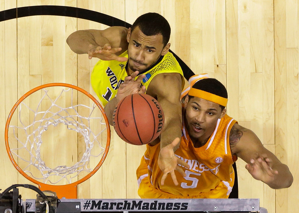 . Michigan\'s Jon Horford and Tennessee\'s Jarnell Stokes (5) go after a rebound during the second half of an NCAA Midwest Regional semifinal college basketball tournament game Friday, March 28, 2014, in Indianapolis. (AP Photo/Michael Conroy)