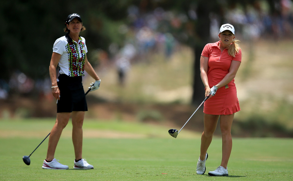 . Stephanie Meadow of Northern Ireland watches her tee shot at the par 4, second hole with her playing partner Juli Inkster of the USA during the final round of the 69th U.S. Women\'s Open at Pinehurst Resort & Country Club, Course No. 2, on June 22, 2014 in Pinehurst, North Carolina.  (Photo by David Cannon/Getty Images)