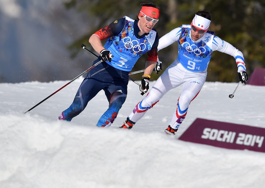 . Silver medalist Maxim Vylegzhanin of Russia (R) and bronze medalist Ivan Perrillat Boiteux of France in action during the Men\'s 4 X 10km Relay competition at the Laura Cross Country Center during the Sochi 2014 Olympic Games, Krasnaya Polyana, Russia, 16 February 2014.  EPA/HENDRIK SCHMIDT