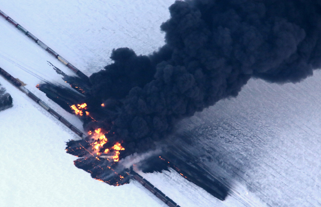 . A fire from a train derailment burns uncontrollably as seen in this aerial photograph Monday, Dec. 30, 2013, west of Casselton, N.D. No one has been reported hurt in the derailment or fire. By late Monday afternoon, the smoke plume was diminishing and was staying mostly away from town. (AP Photo/The Forum, Michael Vosburg)