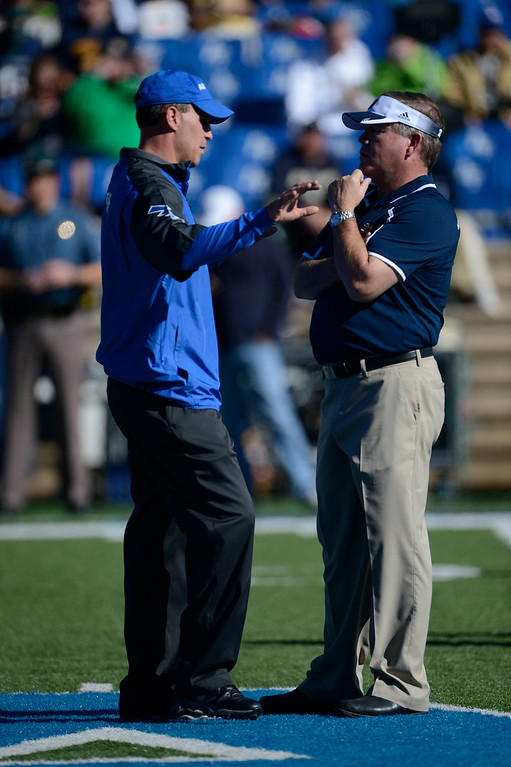 . COLORADO SPRINGS, CO - OCTOBER 26: Air Force head coach, Troy Calhoun, left, talks with Notre Dame head coach, Brian Kelly, at mid-field before the game at Falcon Stadium Saturday afternoon, October 26, 2013. (Photo By Andy Cross/The Denver Post)