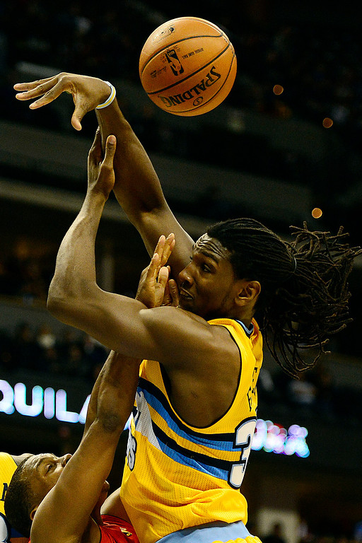 . Denver Nuggets small forward Kenneth Faried (35) collides with Toronto Raptors point guard Kyle Lowry (3) during the second half of the Nuggets\' 113-110 win at the Pepsi Center on Monday, December 3, 2012. AAron Ontiveroz, The Denver Post