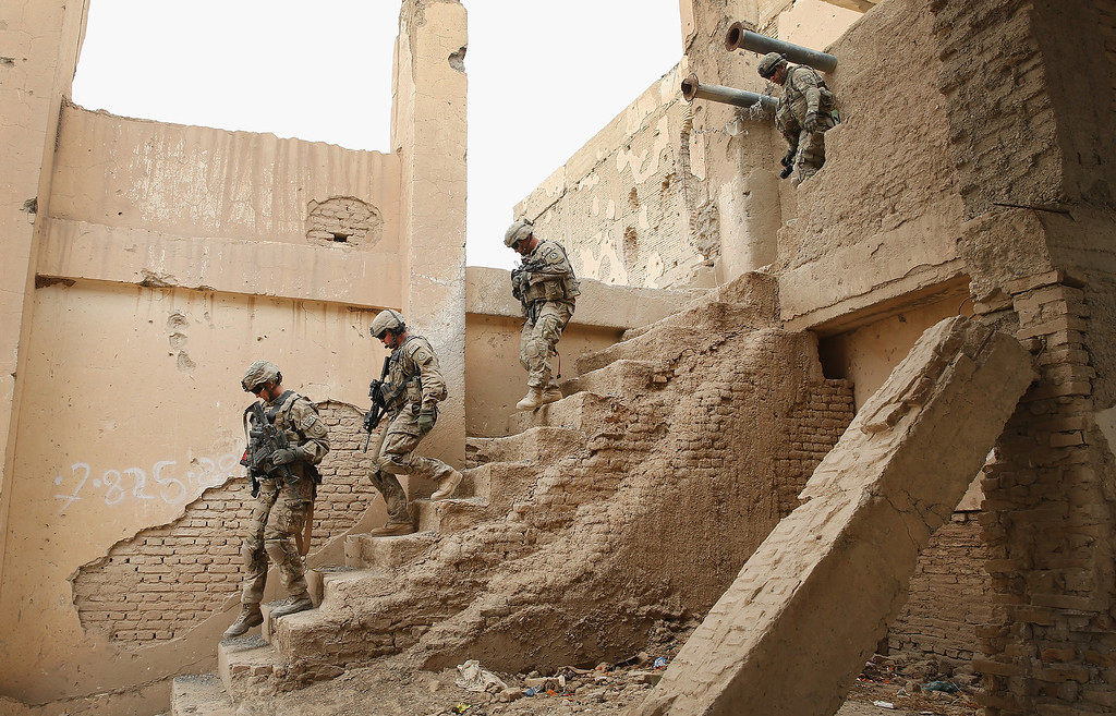 . Soldiers from the U.S. Army\'s 4th squadron 2d Cavalry Regiment visit an Afghan National Police (ANP)outpost that was once home to Osama Bin Laden on February 25, 2014 near Kandahar, Afghanistan.    (Photo by Scott Olson/Getty Images)