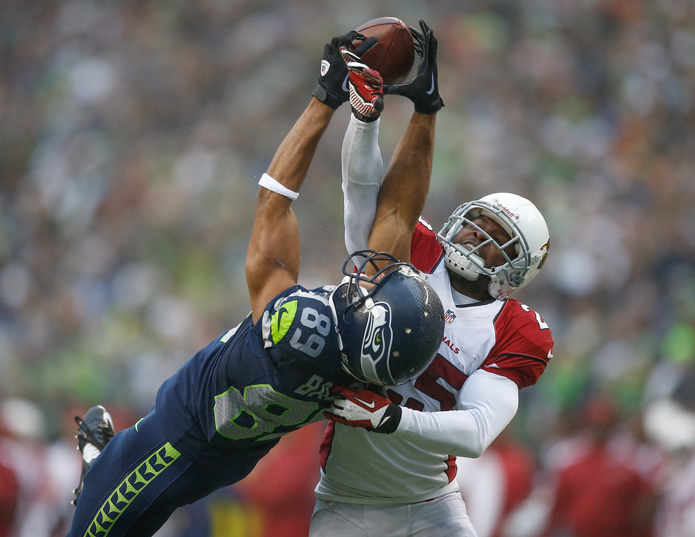 . Wide receiver Doug Baldwin #89 of the Seattle Seahawks has this pass broken up by cornerback Jerraud Powers #25 of the Arizona Cardinals at CenturyLink Field on December 22, 2013 in Seattle, Washington. The Cardinals defeated the Seahawks 17-10.  (Photo by Otto Greule Jr/Getty Images)