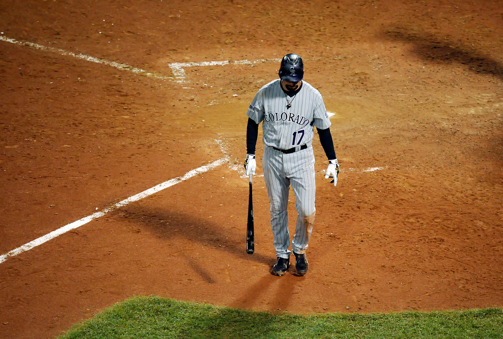 . Todd Helton walks from the plate after striking out in the ninth inning leading the Red Sox to a 2-1 victory over the Colorado Rockies in game two of the World Series between the Colorado Rockies and Boston Red Sox at Fenway Park. The Denver Post,  Karl Gehring
