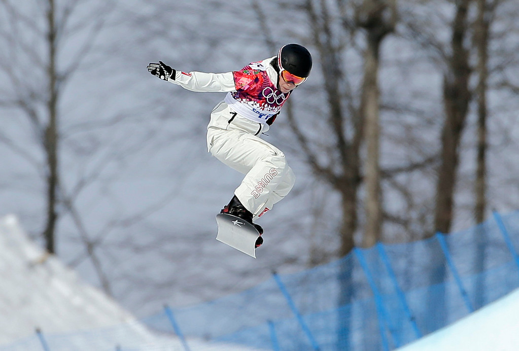. Switzerland\'s Simona Meiler competes in a seeding run during women\'s snowboard cross competition at the Rosa Khutor Extreme Park, at the 2014 Winter Olympics, Sunday, Feb. 16, 2014, in Krasnaya Polyana, Russia. (AP Photo/Andy Wong)