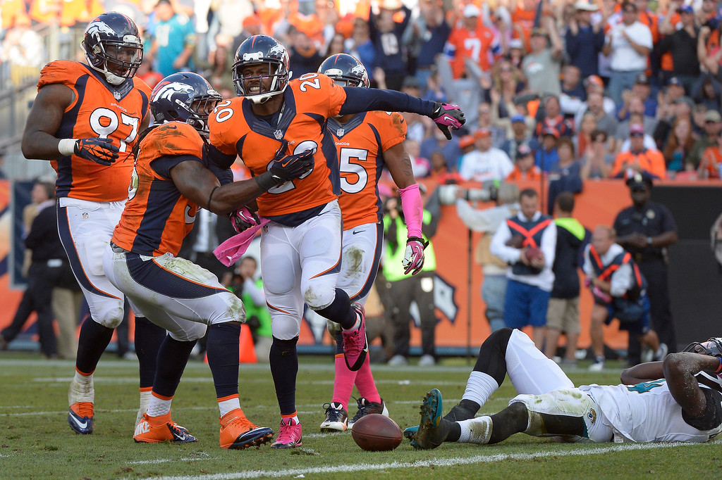 . Denver Broncos strong safety Mike Adams #20 celebrates breaking up a pass to Jacksonville Jaguars wide receiver Justin Blackmon #14 late in the 4th quarter at Sports Authority Field at Mile High. August 13, 2013 Denver, October. (Photo By Joe Amon/The Denver Post)