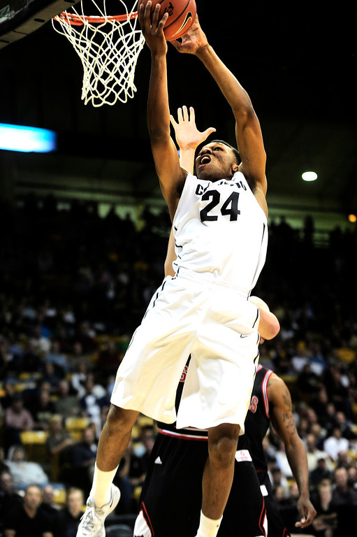 . University of Colorado\'s George King (24) goes to the basket against Arkansas State during their game at the Coors Events Center on the CU Boulder Campus in Boulder, Colorado on November 18, 2013.  Photo by Paul Aiken / The Boulder Daily Camera.