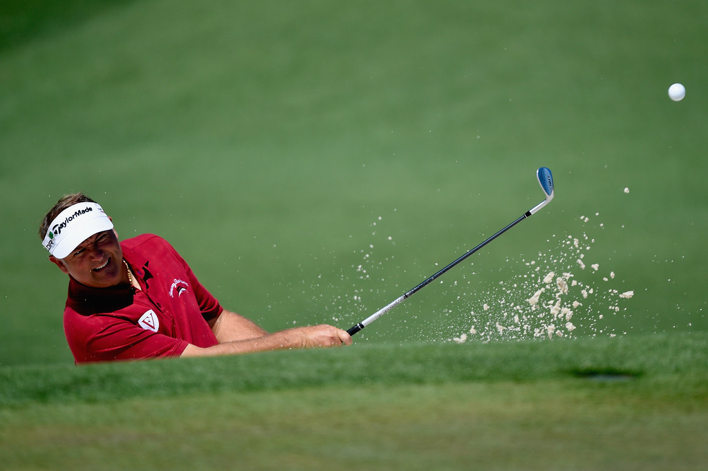 . Ken Duke of the United States plays a bunker shot on the second hole during the first round of the 2014 Masters Tournament at Augusta National Golf Club on April 10, 2014 in Augusta, Georgia.  (Photo by Harry How/Getty Images)