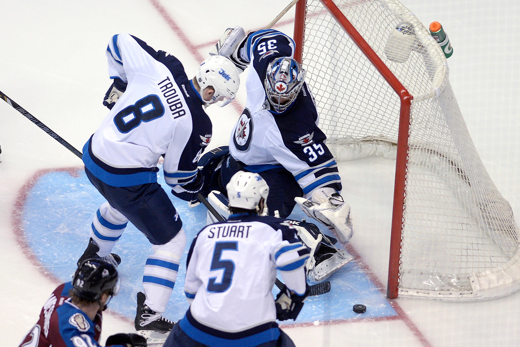 . Al Montoya (35) of the Winnipeg Jets stops a shot by Gabriel Landeskog (92) of the Colorado Avalanche during the first period. (Photo by AAron Ontiveroz/The Denver Post)
