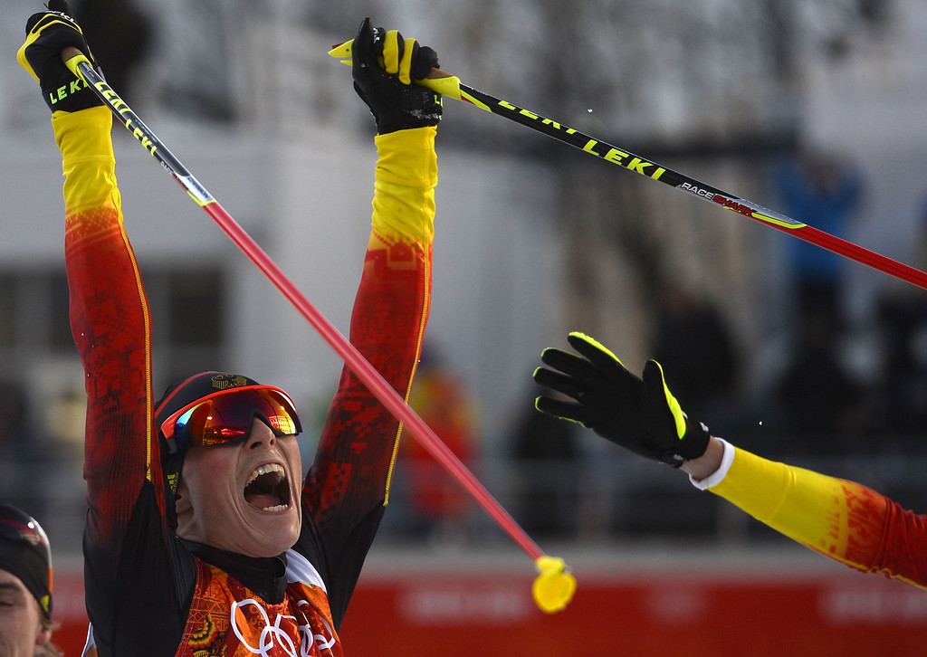 . Gold medalist Germany\'s Eric Frenzel (1) celebrate his win at the finish line of the Nordic Combined Individual NH / 10 km Cross-Country at the RusSki Gorki Jumping Center during the Sochi Winter Olympics on February 12, 2014 in Rosa Khutor near Sochi.  AFP PHOTO / PIERRE- MARCOU/AFP/Getty Images