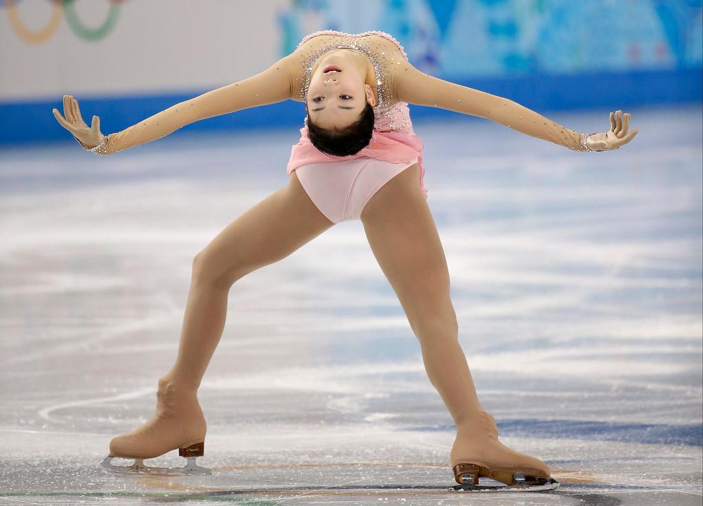 . Li Zijun of China competes in the women\'s free skate figure skating finals at the Iceberg Skating Palace during the 2014 Winter Olympics, Thursday, Feb. 20, 2014, in Sochi, Russia. (AP Photo/Bernat Armangue)
