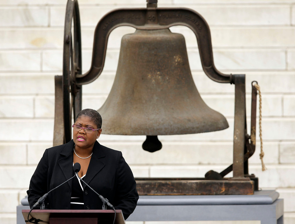". Melanie Campbell, president & CEO of the National Coalition on Black Civic Participation, speaks at the Let Freedom Ring ceremony at the Lincoln Memorial in Washington, Wednesday, Aug. 28, 2013, to commemorate the 50th anniversary of the 1963 March on Washington for Jobs and Freedom. It was 50 years ago today when Martin Luther King Jr. delivered his ""I Have a Dream\"" speech from the steps of the memorial. The bell at rear rang at the 16th St Baptist Church in Birmingham, Ala. which was bombed 18 days after the March On Washington killing four young girls.  (AP Photo/Carolyn Kaster)"