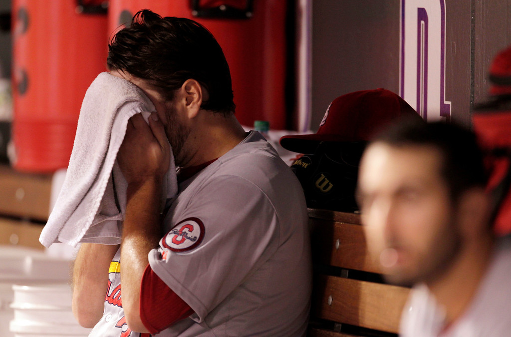 . St. Louis Cardinals starting pitcher Lance Lynn wipe his face in the dugout after the fifth inning of a baseball game against the Colorado Rockies in Denver on Monday, Setp. 16, 2013.(AP Photo/Joe Mahoney)