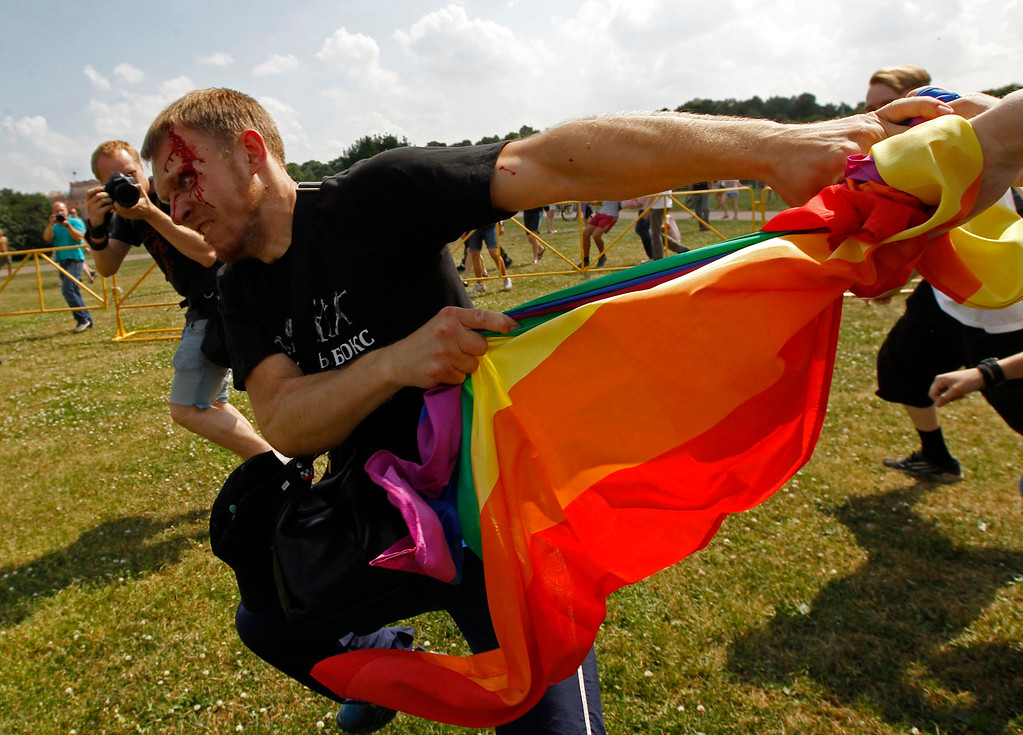 . An anti-gay protester clashes with gay rights activists during a Gay Pride event in St. Petersburg, June 29, 2013. Dozens of gay and lesbian rights activists and their supporters gathered for the event but were attacked by anti-gay protesters and later dispersed by the police. REUTERS/Alexander Demianchuk