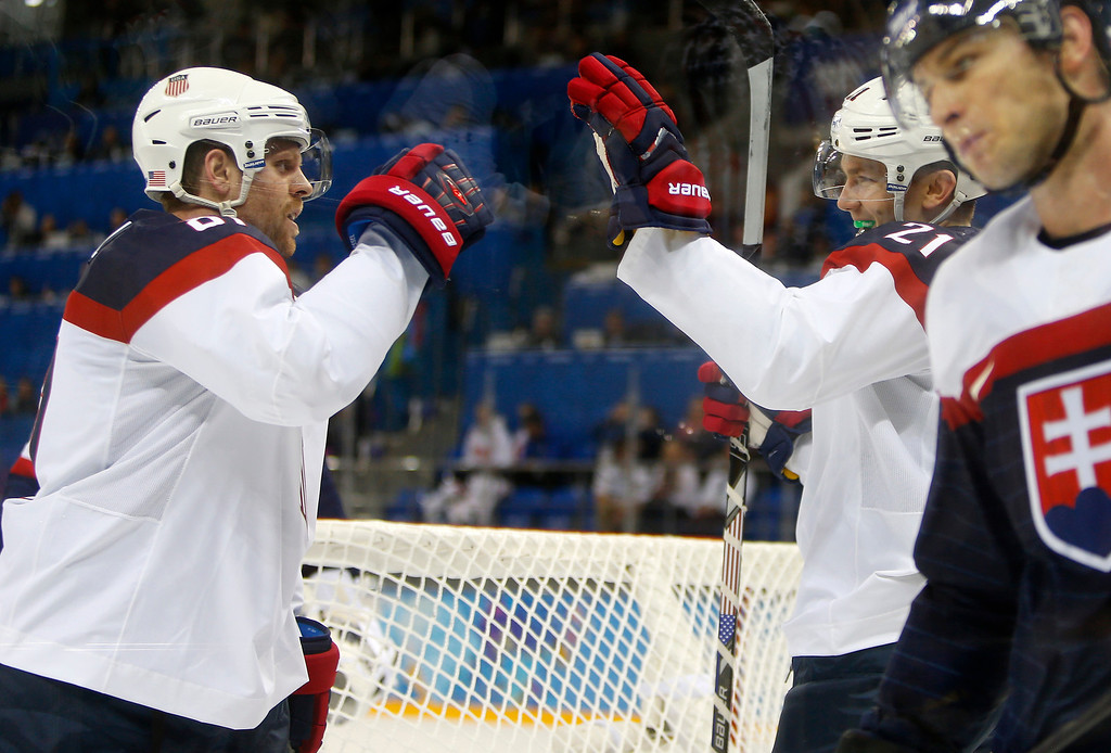 . USA\'s James Van Riemsdyk (21) congratulates USA\'s Phil Kessel (81) on his goal against Slovakia in the second period for their preliminary round at the Shayba Arena for the 2014 Winter Olympics in Sochi, Russia on Thursday, Feb. 13, 2014.  (Nhat V. Meyer/Bay Area News Group)