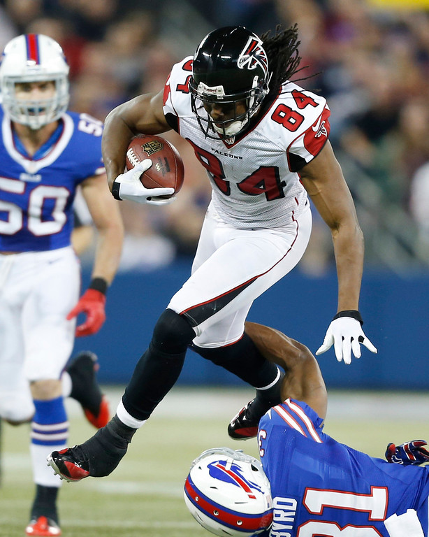 . Atlanta Falcons wide receiver Roddy White (84) jumps over Buffalo Bills free safety Jairus Byrd (31) during the first half of an NFL football game on Sunday, Dec. 1, 2013, in Toronto. (AP Photo/Gary Wiepert)